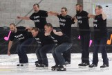 Fathers try their hand at synchro skating. From the left are, in front: Dan Brenneman, Paul Brenneman, Tony Koot; behind: Jeremy Weicker, Mark Brenneman, Doug Podann, Chad Ziegler.
