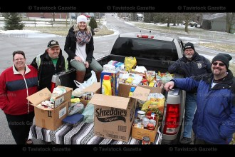 Happy with the donations to the T.A.P. Food Drive on Saturday, March 18th are organizers, from the left, Diana and Calvin Drury, Elizabeth Jones, Byron Kropf and Darryn Martin.