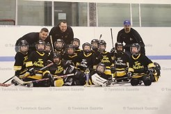 The Tavistock Titan Tyke team that won the Jimmy Roth Tournament last Friday include, from the left: Evan Nahrgang, Ryan Zehr, Marshall McKay, Wiatt Robinson, Mac Munroe, Jackson MacMillan, Parker Glitz, Camden Bartlett, Carter Cook, Isaiah Pastoor, Keagan McMahon, Dylan McCann, Cameron Faulhafer, Spencer Otto (goalie in front). Coaches behind, left to right: David Johnson, Corey McCann and Doug Bauman.