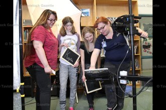 LifeTouch photographers Stacey VanderVlag (right) and Leslie Finch (left) show Tavistock Public School Grade 7 students Melia Britton and Kayla Gushue their photographs following a photo session at the school last Monday, April 3rd, 2017.