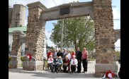 Members of the former Tavistock Women's Institute cut the ribbon to officially re-open the Queen's Park stone gates on Saturday morning, May 13, 2017. From the left are Doris Gladding, Anne Matresky, Jean Houghton and Shirley Ramseyer. Behind are RCMP Constable Mona Eichmann, stonemasons Robin and Kyle Gilholm, and officials Oxford MP Dave MacKenzie, Restoration Committee Chair Shirley Hanlon, FWIO President Margaret Byl, Pastor Jim Brown and East Zorra-Tavistock Mayor Don McKay.