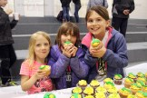 Enjoying the 50th anniversary cupcakes were, from the left, Claire Rempel, Lexi and Derek Schultz.