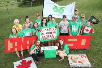 The Community 4-H Club is shown at the Relay for Life in Woodstock - left to right, back row,: Pat Black, Hailee Verhoeven, Liam Pullen, Janet Bruce, Ben Bruce, Shonna Ward; front row: Emily Schwartzentruber, Emma Pullen, Jenna VanBoekel, Tina Nauta, Amanda Witmer, Keeton Jones, David Pullen, Jacob Bergsma; and kneeling: Megan Verhoeven, Laura Witmer. Absent when the photo was taken were Jessie Carberry and Thomas Knoops.
