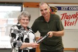 Ruthe Arnott receives her Community Achievement Award from EZT Councillor Jeremy Smith.