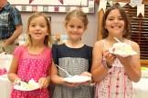 Stella Hawkins, Addison Weicker, and Mia Hawkins enjoys the anniversary cake at Tavistock Mennonite Church 75th anniversary on Sunday, June 25, 2017.