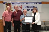 Ken Mogk is presented with the Senior of the Year award by Agricultural Society President Mona Eichmann. At left is Mayor Don McKay and Trinity Church Council Chair Richard Wilker.