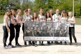 The Novice Girls who won gold at the Waterloo tournament, posing with the team banner are from left: Ashley Dehn, Emily Smith, Hanneke lsert Bender, Leah Yantzi, Lauren Segeren, Jill Gole, Danielle Bast, Lauren Baechler, Danielle Ramseyer, Kimberly Satchell, Rayne Bowden, Becky McIntosh. Absent from photo were coaches: Rick McIntosh, Barb Wilhelm, Jim Baechler and Scott Ramseyer.