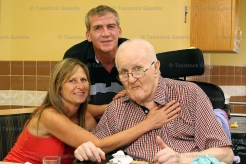 peopleCare resident Hugh Briddle, celebrating his 83rd birthday, and formerly of Ingersoll, gets a hug from his niece Teresa and son, Joe, during a Father's Day Social at the home on Saturday afternoon, June 17th.