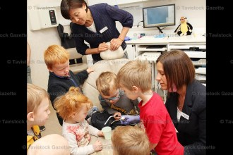 Office Manager Deborah Schippling helps pre-schoolers with the water and suction tools during a tour of Tavistock Dental last Tuesday, June 6th. Administrative Assistant Eunmi Kim (top) looks on. From the left are students: Grady McCallum Moesker, Daniek Vosters, Toby Vosters (behind), Noah Snyder (glasses) and Clayton McKay.