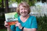 Carolyn Wilker displays her new book which is available at carolynwilker.ca