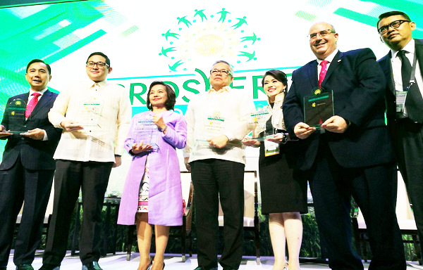 CALL FOR THE STANDARDIZATION OF TARIFF MEASURES AMONG ASEAN MEMBER STATES During the ASEAN Prosperity Summit in Metro Manila, Department of Trade and Industry (DTI) and ASEAN Economic Ministers (AEM) Chair 2017 Secretary Ramon Lopez (3rd from L) recently (28 April) called for the standardization of tariff measures among ASEAN Member States that would pave the way to the reduction of trade barriers in the region. The trade chief believes that allowing a more liberal trade flow would eventually lead to prosperity in ASEAN, spurring greater competition in goods and services. Sec. Lopez was part of the Summit's panelists along Pampanga 2nd District Representative and former President Gloria Macapagal-Arroyo (3rd from L), Senator Bam Aquino (2nd from L), Former Secretary of Department of Agriculture Dr. William Dar (leftmost) and The Royal Group (Cambodia) Senior Vice-President Rami Sharaf (rightmost). The Summit's Session 1 focused on creating an enabling environment in achieving prosperity for all and was moderated by broadcast journalist Cathy Yang (2nd from R). Wrapping the session, Sec. Lopez urged businesses to take part of the prosperity movement and include the micro, small and medium enterprises into a bigger global market. (Photo courtesy of DTI)