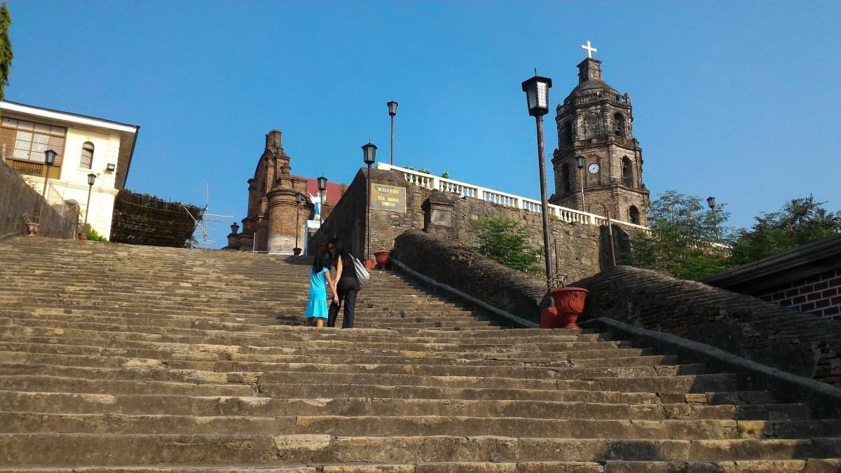 Dr. Daisy Joy Espejo Torina and Monique Torina walk up the steps leading to the Church of Our Lady of the Assumption, Sta. Maria, Ilocos Sur. (photo by Jasper A. Espejo)