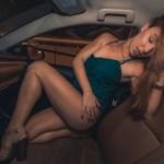 tawny swain, tan, legs, car, green dress