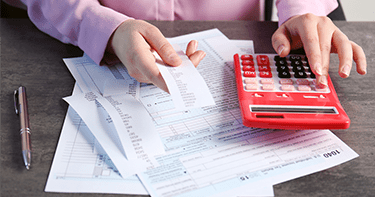 financial planner fills out tax paper work