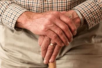 elderly man holding cane