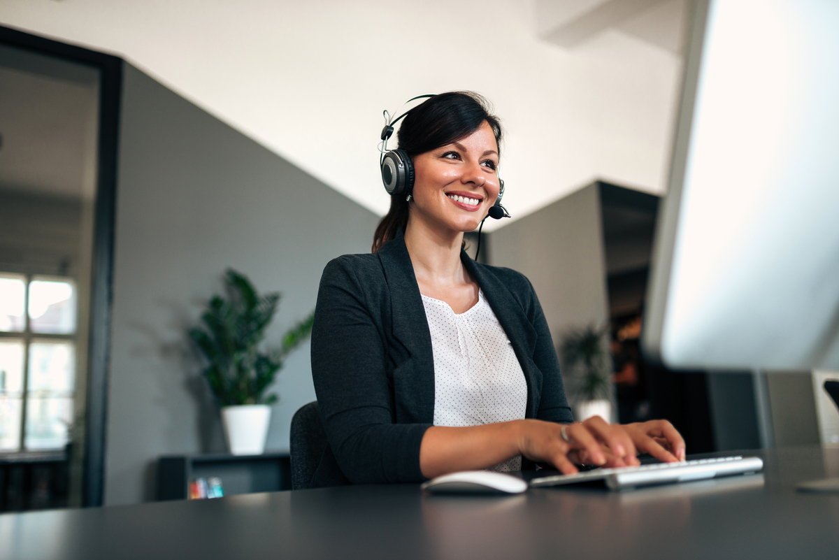 Close-up image of happy woman with headset.