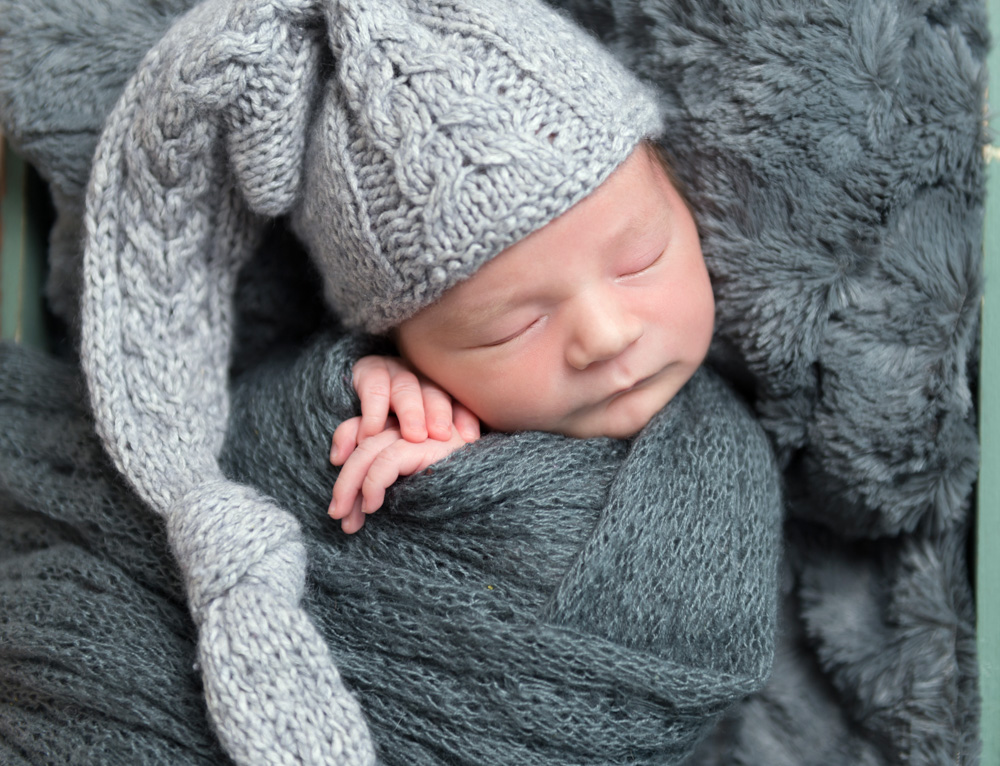Cute child sleeping in hat, closeup