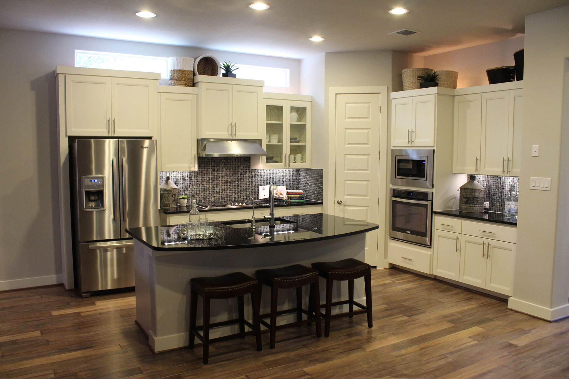 White kitchen cabinet with transitional combination frame