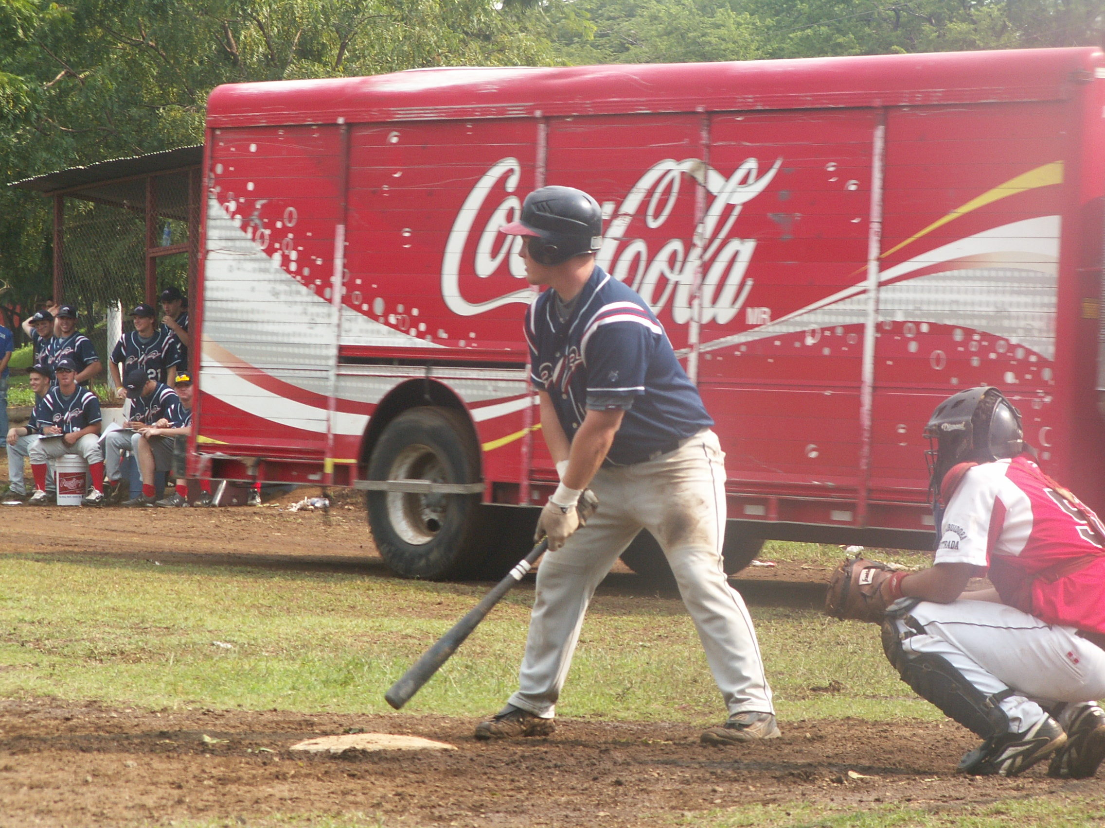 AIA Nicaragua Baseball player Ty Shaw is at bat.  Please nottice the CocaCola Truck driving in between him and our dug out during the game.  This and many other surprises magically appear during the games ! lol