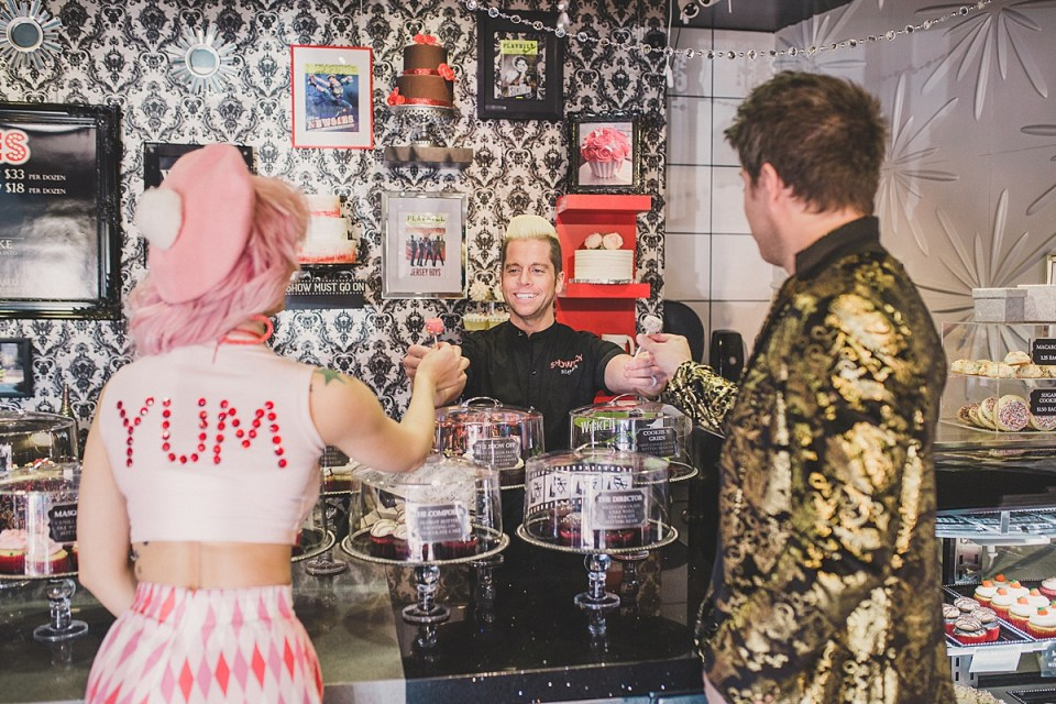 Showboy Bakeshops' co-owner Stephen Lowry handing off a couple of tast y cake pops to Annalee Belle & JD Scott.