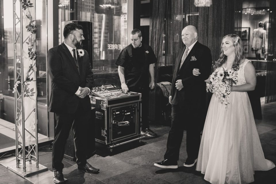 Hard Rock Cafe wedding ceremony photographed by Taylor Made Photography