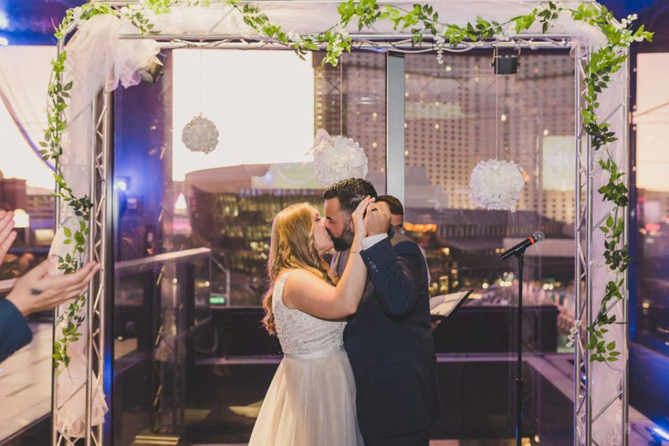 first kiss as husband and wife at Hard Rock Cafe by Taylor Made Photography