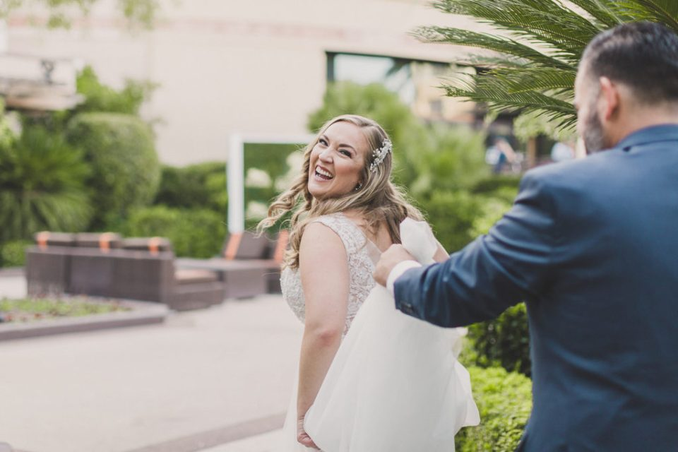 bride and groom are playful during first look photographed by Taylor Made Photography