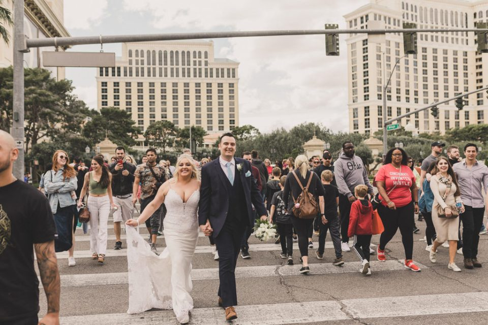bride and groom walk on the street in Las Vegas by Taylor Made Photography