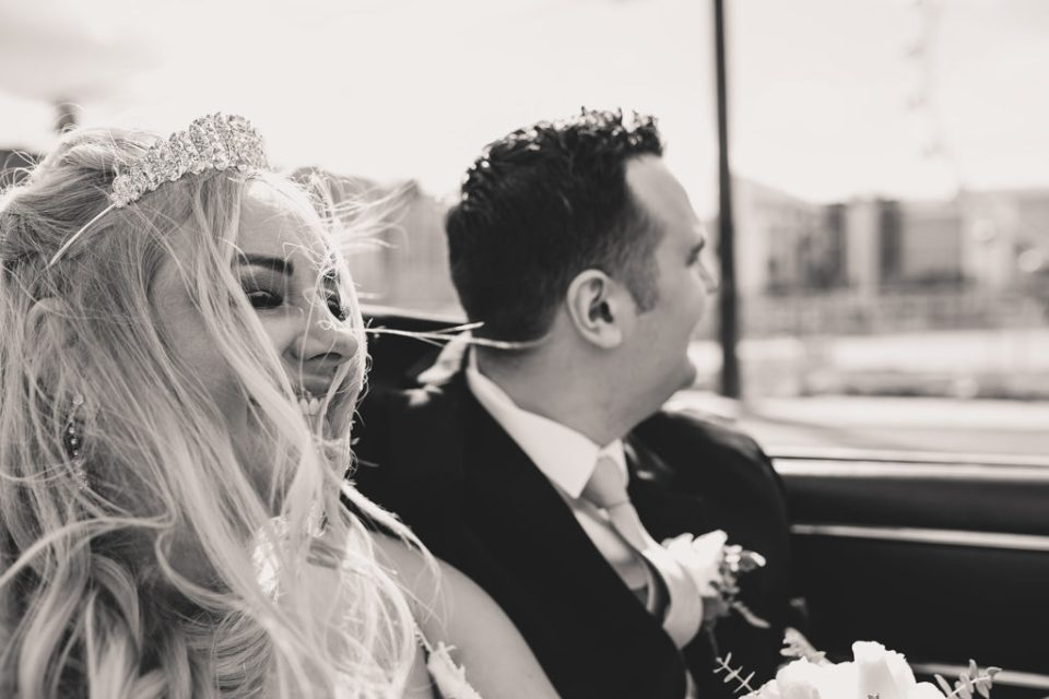 bride and groom drive in Las Vegas on wedding day with Taylor Made Photography