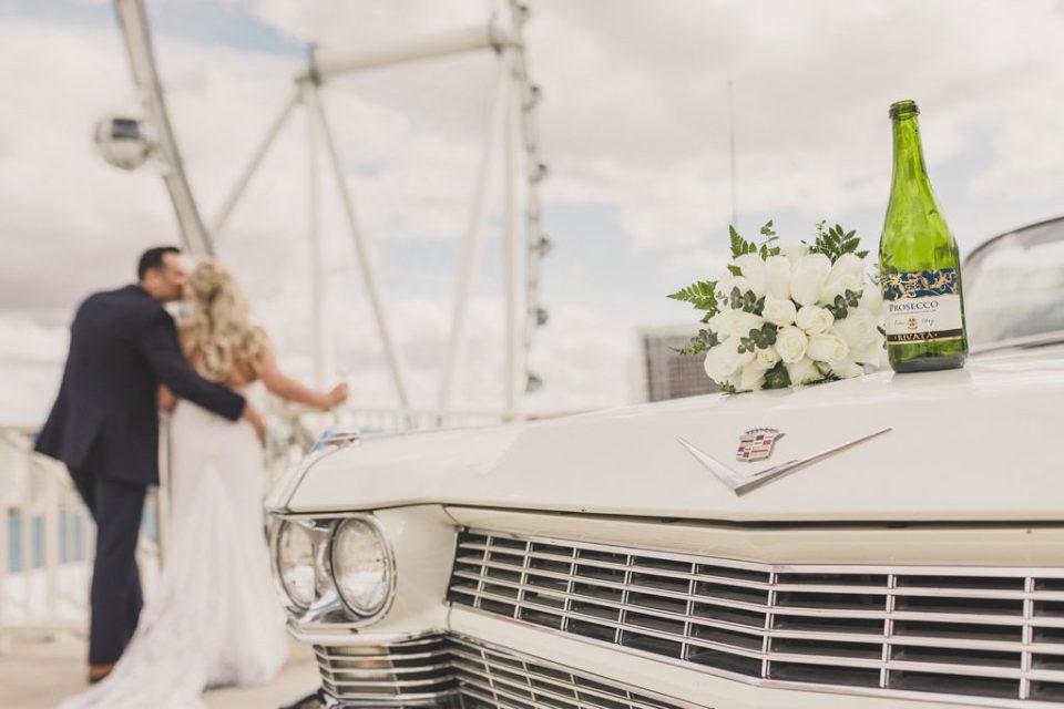 bride and groom watch Las Vegas Observation Wheel