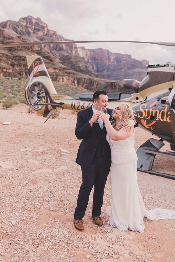 bride and groom toast wedding day in Grand Canyon