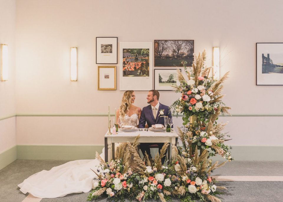 bride and groom eat at sweetheart table during wedding day in Las Vegas
