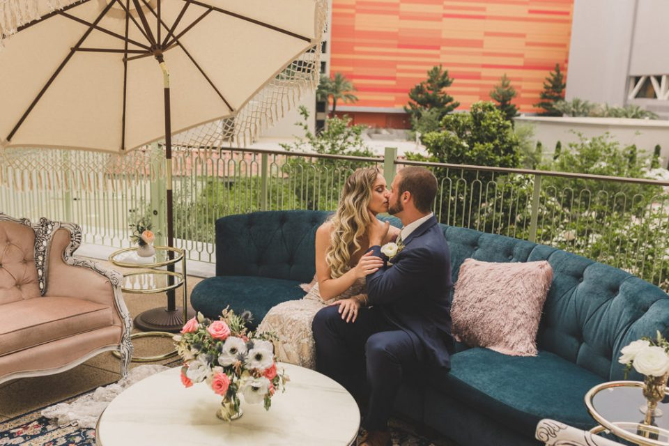 bride and groom kiss on Central Park Terrace at Park MGM