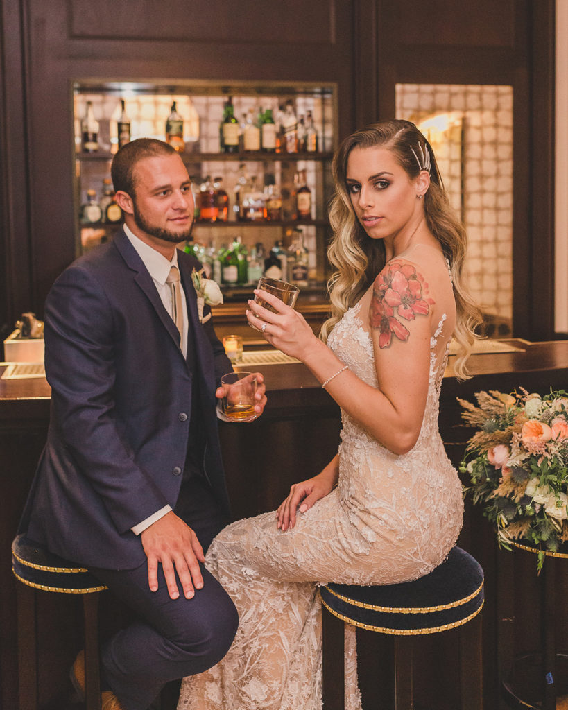 bride and groom have drink on wedding day at Park MGM with Taylor Made Photography