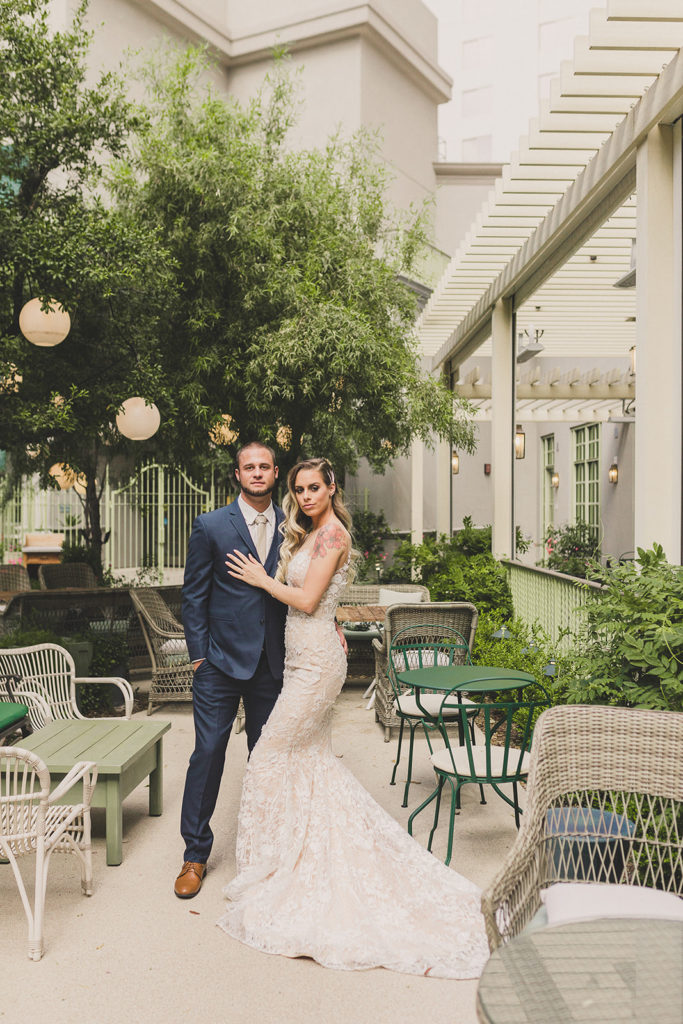 bride and groom outside on patio during styled shoot with Taylor Made Photography