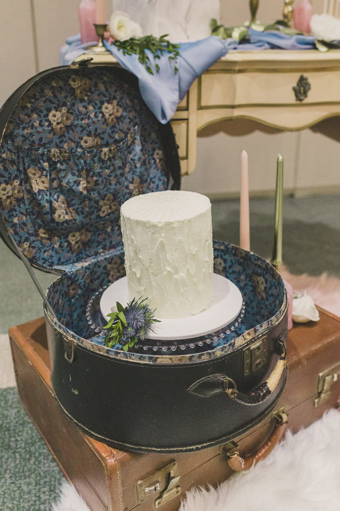 one tiered wedding cake in vintage suitcase photographed by Taylor Made Photography