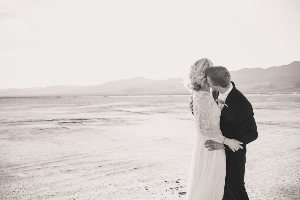Taylor Made Photography captures bride and groom embracing during wedding portraits