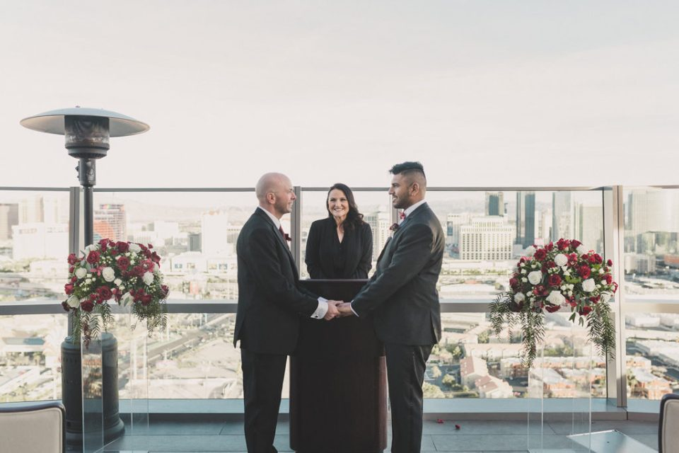 grooms elope on rooftop of Las Vegas hotel photographed by Taylor Made Photography