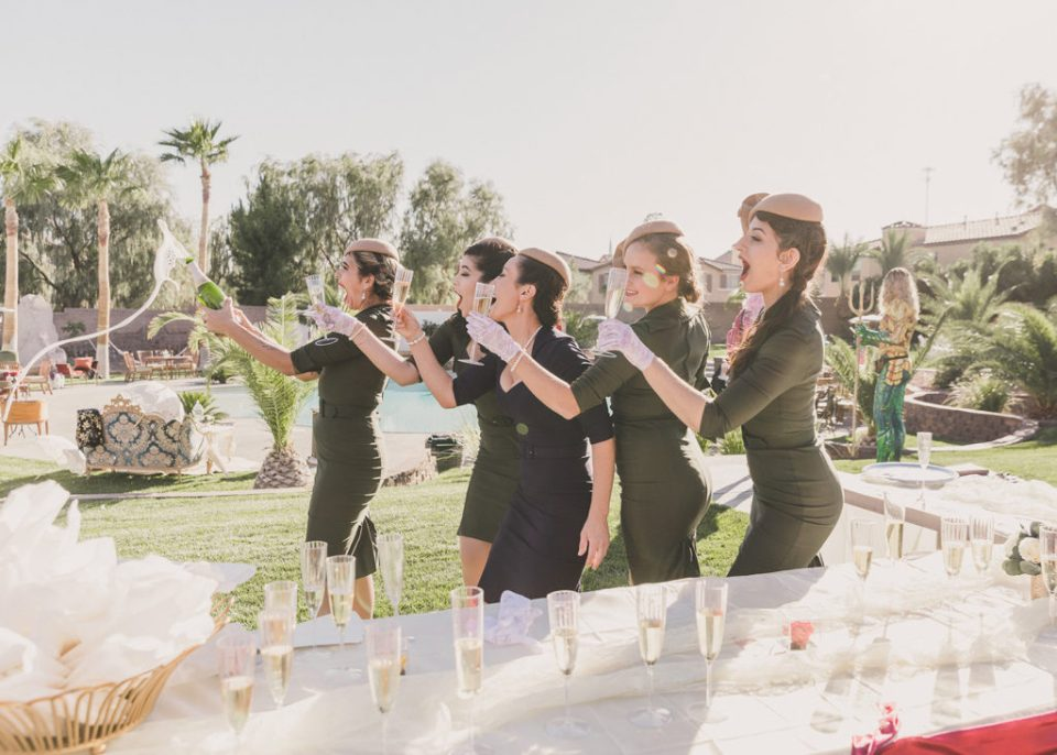 wedding guests toast before Las Vegas ceremony photographed by Taylor Made Photography