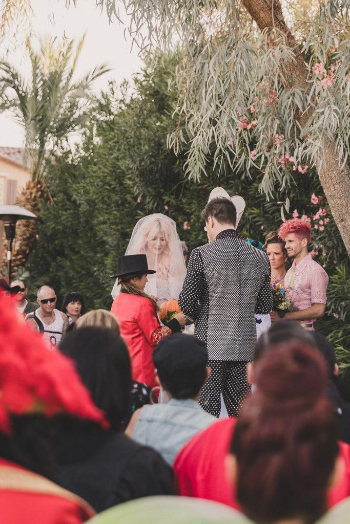 bride and groom exchange rings at Lotus House