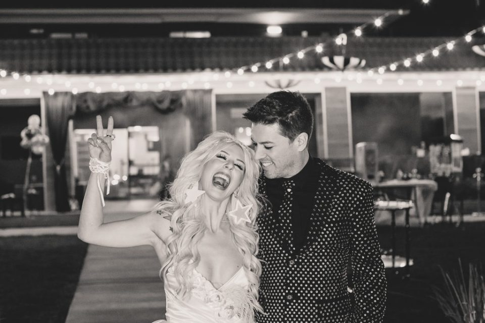 bride and groom enter Las Vegas wedding reception photographed by Taylor Made Photography