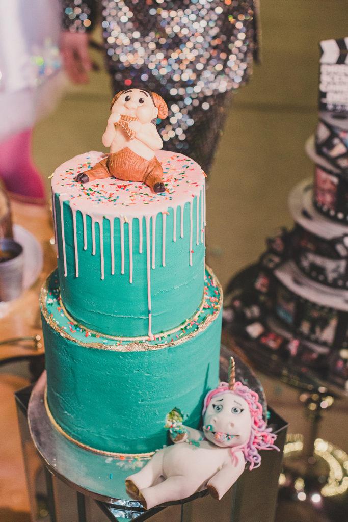 teal wedding cake with unicorn