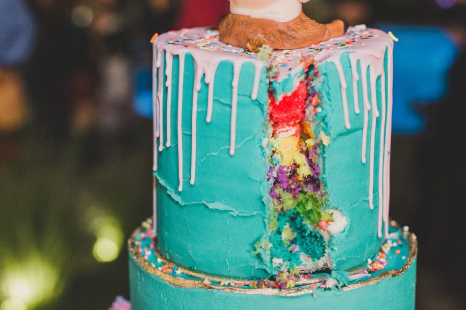rainbow wedding cake with drip icing