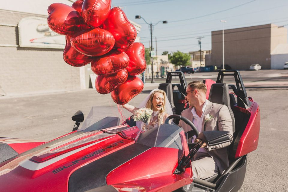 Taylor Made Photography photographs bride and groom in rental sports car