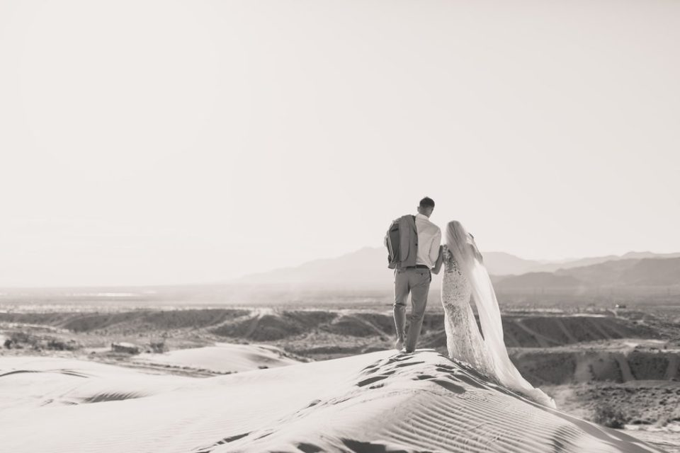 black and white portrait of bride and groom on sand dunes with Taylor Made Photography