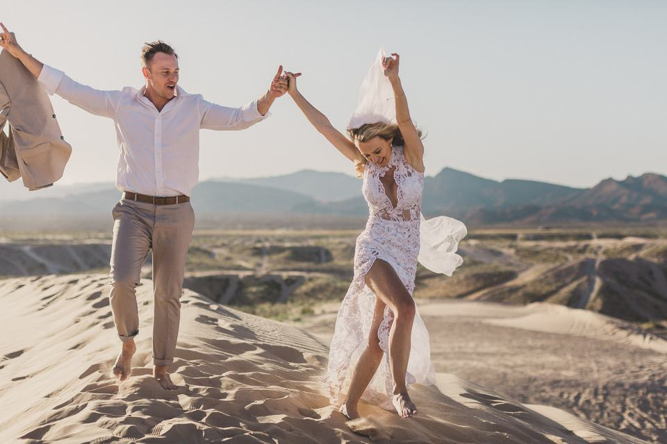 joyful newlyweds photographed by Taylor Made Photography