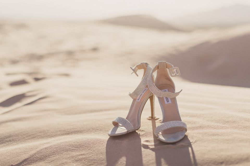 Taylor Made Photography captures bride's shoes on sand dunes