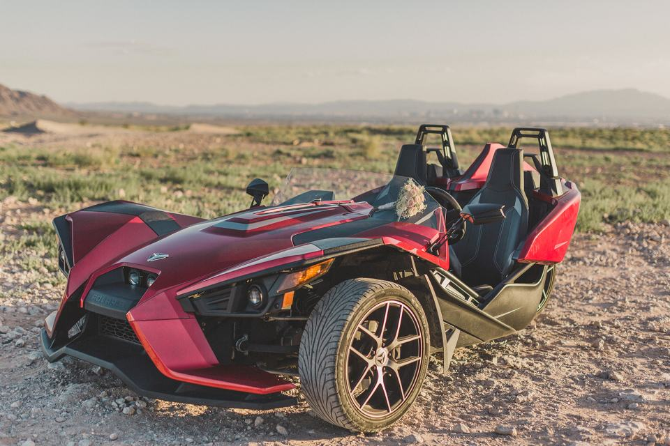 rental car on sand dunes for adventurous Las Vegas elopement photographed by Taylor Made Photography