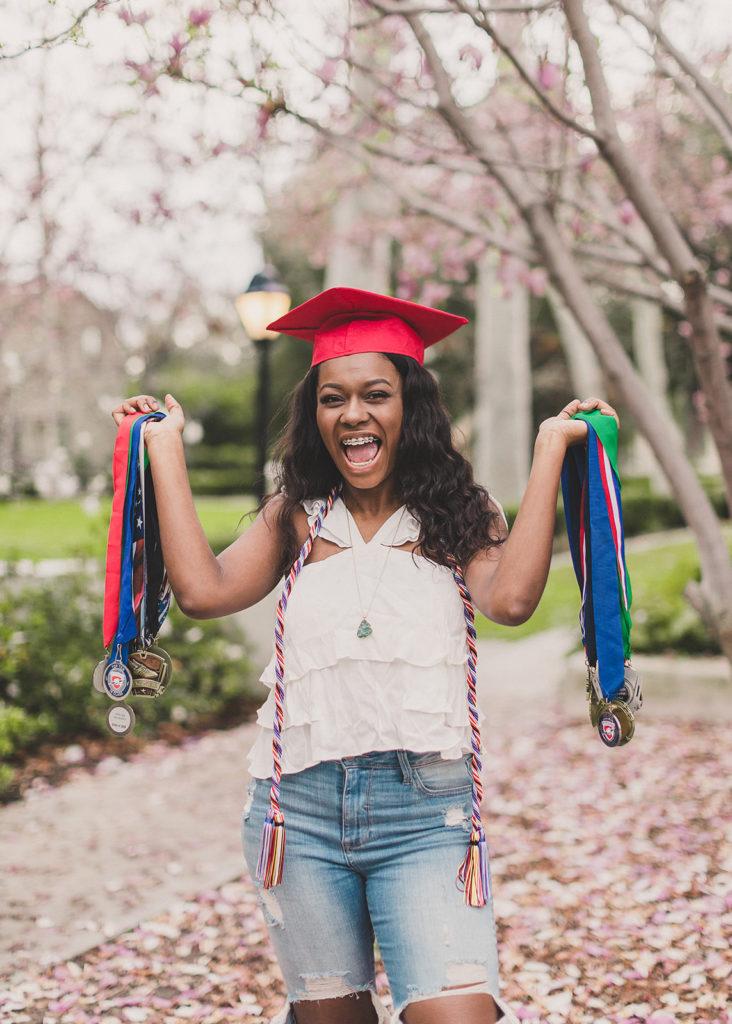 Taylor Made Photography photographs senior celebrating graduation