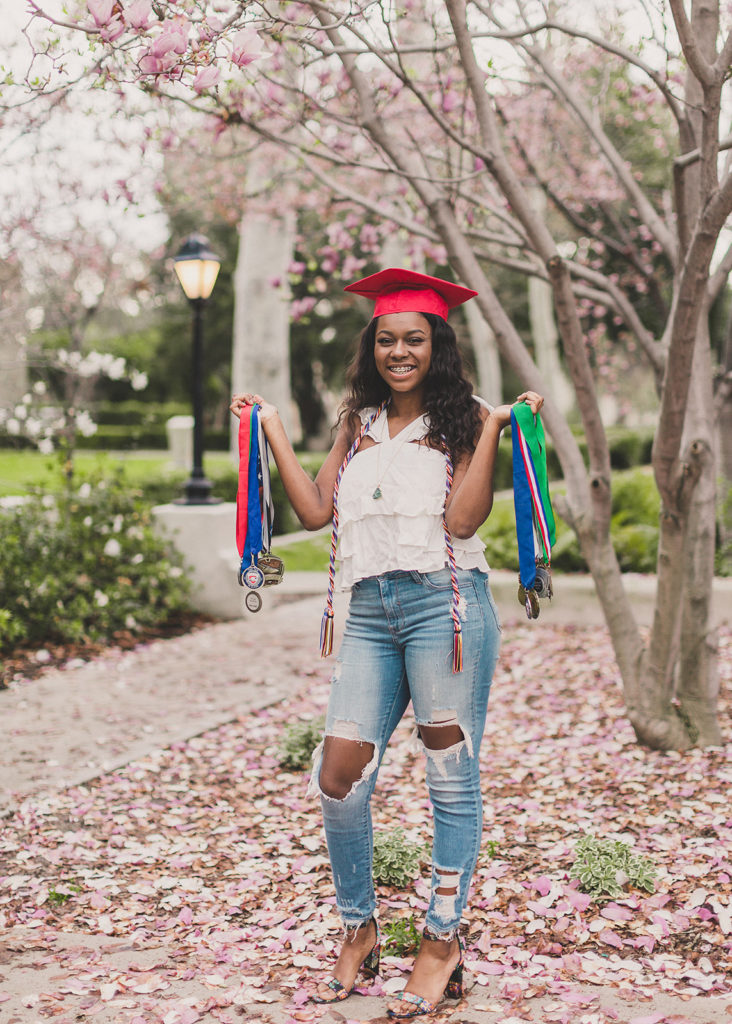 graduate with cords and medals photographed by Taylor Made Photography
